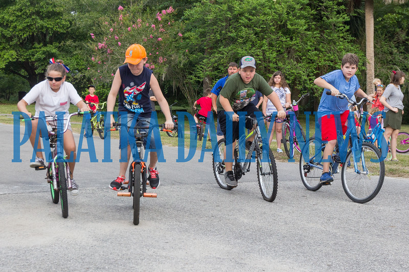 The middle-schoolers get off to a fine start in their leg of the Firecracker Bike Race sponsored by Putnam Bikes to begin the Interlachen Independence Day Celebration. Fran Ruchalski/Palatka Daily News