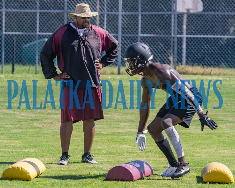 Crescent City Raiders Coach Williams studies Kevin Williams moves during practice on Tuesday afternoon. Fran Ruchalski/Palatka Daily News