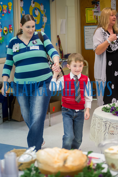 Joseph Smith, 6, escorts his mom, Amy Smith into Ms. Greene's class for the Mother's Day celebration at Interlachen Elementary School on Friday morning. Fran Ruchalski/Palatka Daily News