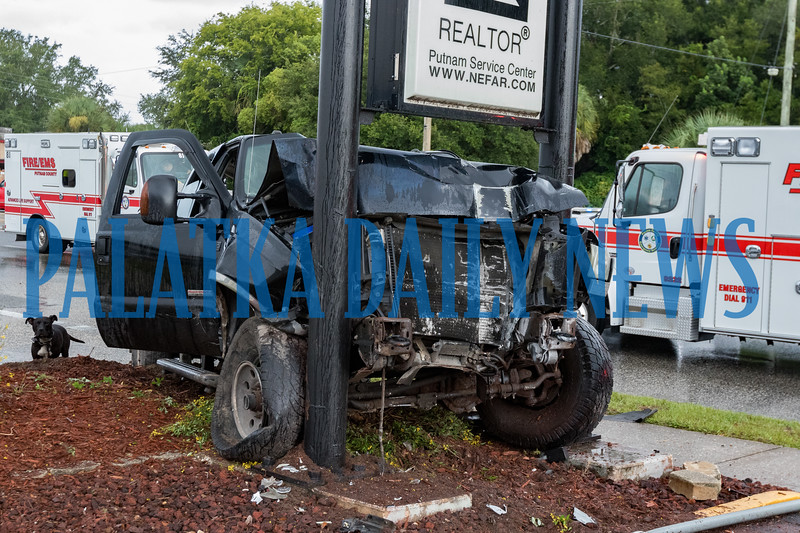 This pickup crashed with a passenger car at 19th and Reid Streets Friday morning, destroyed a concrete electric pole, bringing down wires into the roadway and came to rest in this sign at 18th Street. Fran Ruchalski/Palatka Daily News