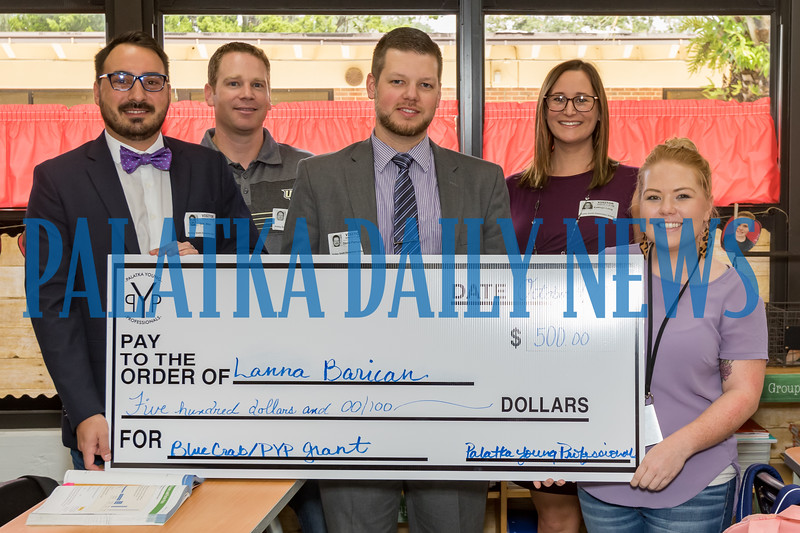 Kelley Smith Elementary teacher Lanna Barican, right, received a $500 grant from the Palatka Young Professionals to add some STEM projects for her students. Members of the PYP pictured from left are Seth Miles, Benji Bates, David Parsons, and Katie Long. Fran Ruchalski/Palatka Daily News