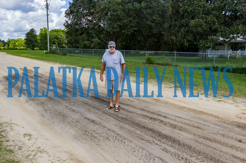 Beasley stands in the growing soft spot in the 100 blk. of Bahia Top Drive in Melrose outside his home. What started as a three-foot area three weeks ago has now stretched to about ten times that size. Fran Ruchalski/Palatka Daily News