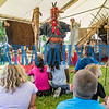 Jim Sawgrass of the Florida Muskogee Creek Tribe as The Long Warrior shows how Native Americans used alligator tails and the skin of a gar fish as a quiver for their arrows at the Bartram Frolic learning experience for schoolchildren on Tuesday morning. Fran Ruchalski/Palatka Daily News