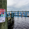 In plain view of the health alert posters, people continue shrimping in the St. Johns River on Wednesday morning. Fran Ruchalski/Palatka Daily News