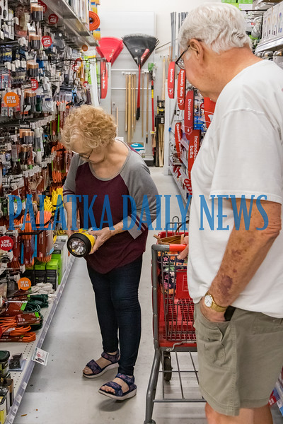 "Mary Anne Conn and Kelly Nash of Satsuma shop for flashlights and batteries at Hagan Ace Hardware in East Palatka Wednesday to get ready for the coming storm. ""You'd think as lifelong Floridians, we'd have this figured out by now,"" said Conn. Fran Ruchalski/Palatka Daily News"