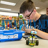 Chris Beattie, 15, makes modifications on his Milo robot to make it faster at the Lego Robotics Bootcamp at the Palatka Library on Thursday evening. These workshops are open to children and teens ages 6-18 and their parents where they learn the basics of computer programming using simple robots they assemble and program. Fran Ruchalski/Palatka Daily News