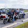 Motorcyclists get ready to mount up to continue riding in the first Constant Aviation Fisher House benefit ride on Wednesday afternoon after having lunch at the Palatka Airport. Fran Ruchalski/Palatka Daily News