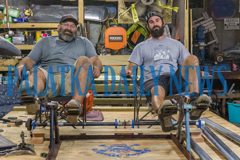Justin Morris, left, and Matt Harris get on the Swamp Monkey to test out their power system for the raft that they hope will continue their win streak in the Ocklawaha Raft Race this year. Fran Ruchalski/Palatka Daily News