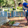 Crescent City High School senior Shyan Kanger, 17, who will soon be going into the Navy, plants a flag on a veteran's grave at the Eden Cemetery in Crescent City on Monday morning. Flags will be placed on veterans' graves in several cemeteries throughout the week to prepare for Memorial Day. Fran Ruchalski/Palatka Daily News