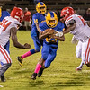 Panthers Sam Smith (23) runs between a pair of Tornadoes defenders in the second quarter. Fran Ruchalski/Palatka Daily News