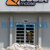 The Boost Mobile store on Reid Street is closed with plastic and sandbags piled up at the front door to prevent water from Hurricane Dorian from getting in. Fran Ruchalski/Palatka Daily News