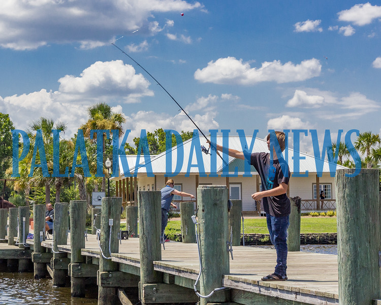 Nathan Whitford, 15, of Okeechobee, Fla. casts off from the dock by the boat ramp at the Palatka Harbor on Thursday afternoon in hopes of landing a catfish. Fran Ruchalski/Palatka Daily News
