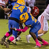 Panthers Kamari Betts (24) and Alvin Perry (20) wrap up a Tornado ball carrier in the first quarter. Fran Ruchalski/Palatka Daily News