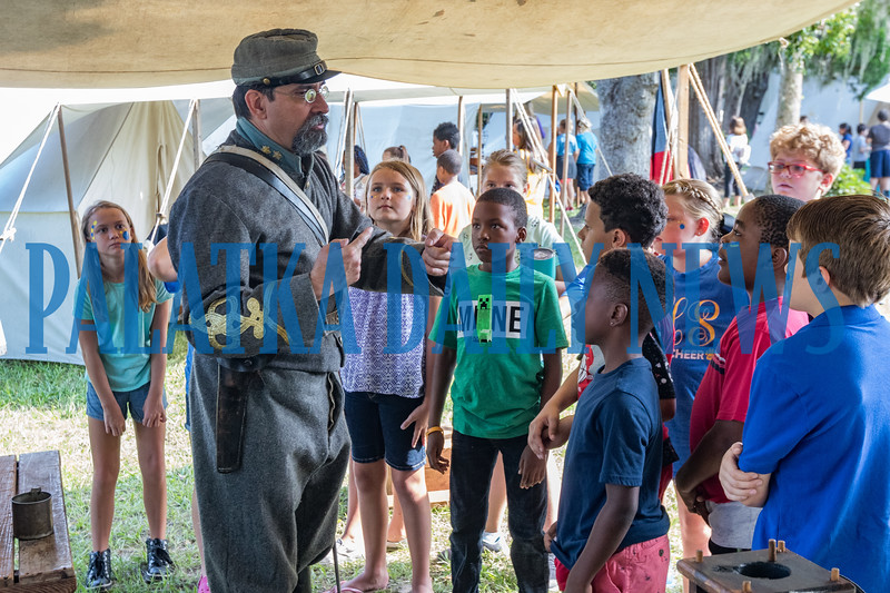 Confederate army officer Keith Kohl tells visiting fourth-graders about life in 1864 at Occupation Palatka on Friday morning. Fran Ruchalski/Palatka Daily News