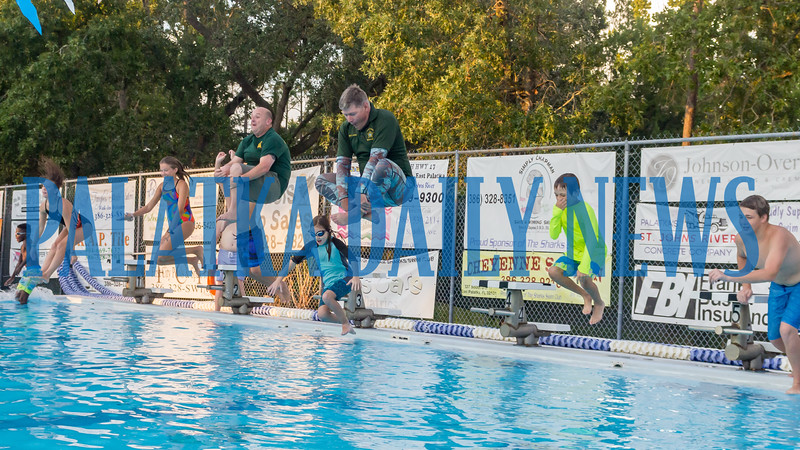 To celebrate the end of summer vacation, the Putnam County Sheriff's Department held a Back to School Pool Party at the Putnam Aquatics Center on Friday night. Getting in the swim of things, PCSO Col. Joe Wells, center, and Master Deputy Denis Jones jumped into the pool with some of the kids who attended. Fran Ruchalski/Palatka Daily News