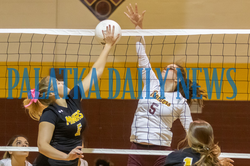 Sophomore Emilia Cendrowska (5) stuffs the ball by Miners senior Dani-Lyn Barnhill (5). Fran Ruchalski/Palatka Daily News
