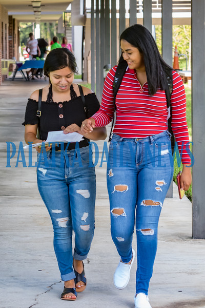 Jessica Alvarez and Brisia Garcia walk through camput at St. Johns River State College for the start of their first semester on Monday morning. Fran Ruchalski/Palatka Daily News