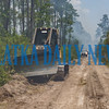 Bulldozers are deployed to tear up some of the would-be fuel for the fire to cross the road into the non-wilderness area of the forest. Fran Ruchalski/Palatka Daily News