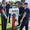 A group of firefighters check out the new mailbox being installed outside the firehouse on 11th Street on Monday morning. Fran Ruchalski/Palatka Daily News