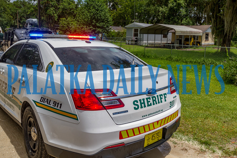 Sheriff's Office vehicles sit outside a residence on McClain Blvd. off Paradise Shores Rd. on Monday afternoon where an armed male subject  barricaded himself in to avoid being charged with domestic violence. Fran Ruchalski/Palatka Daily News
