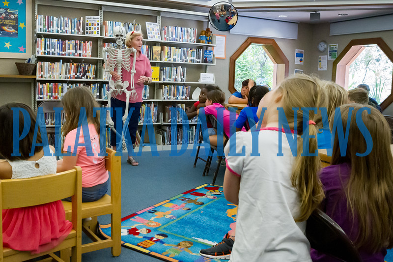 Dr. Holly Thomas introduces her sidekick Leonard to the children at the Full S.T.E.A.M. Ahead Super Science Summer program at the Melrose Library as she teaches them about how the body makes blood. Fran Ruchalski/Palatka Daily News