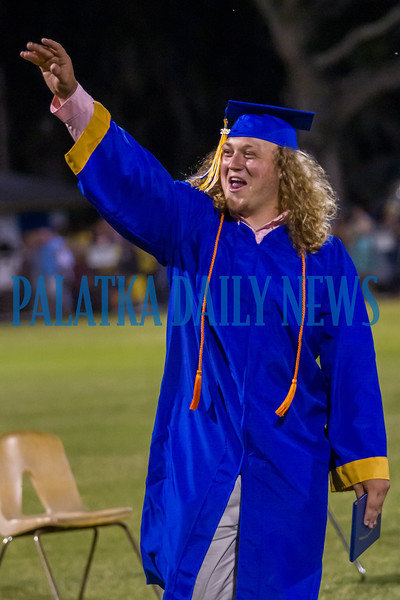 Camden Sweat enthusiastically waves into the crowd after picking up his diploma. Fran Ruchalski/Palatka Daily News