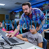 Jeremy Yates, special projects coordinator for the Putnam County Library System helps Jacob Felton, 10, navigate something on his computer during the Generation Mars: Technology Training Camp program at the Palatka library on Monday afternoon. Fran Ruchalski/Palatka Daily News