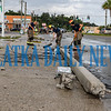 Firefighters clean up the debris from the concrete electric pole destroyed as a result of the accident at 19th and Reid Streets. Fran Ruchalski/Palatka Daily News