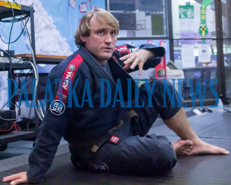 Jiu-jitsu instructor Ben Goodrich talks about the benefits of the martial art for all ages for exercise and self defense during a presentation at the Palatka Library on Friday afternoon. Fran Ruchalski/Palatka Daily News