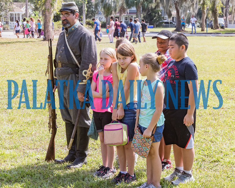 Confederate army officer Keith Kohl uses students to demonstrate how the soldiers would assemble for battle in 1864 at Occupation Palatka on Friday morning. Fran Ruchalski/Palatka Daily News