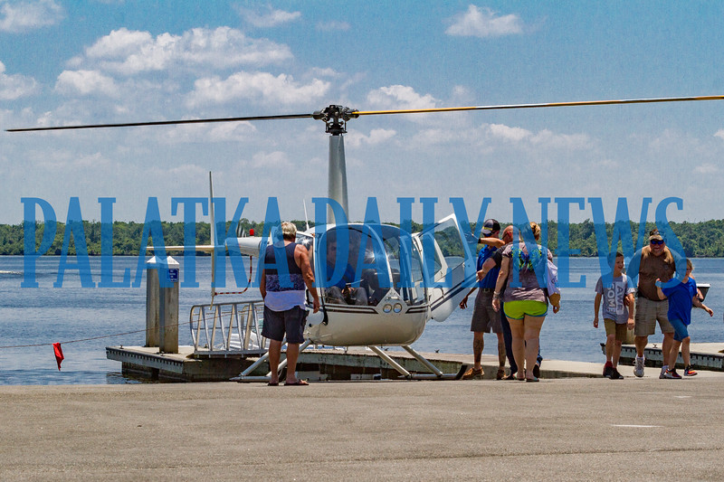 """Helicopter rides were one of the favorite additions to the Blue Crab Festival with flights taking off all day and night. According to the young man who just got off, it was """"so awesome!"""" Fran Ruchalski/Palatka Daily News"""