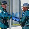 Putnam County Sheriff's Office deputies bring out a flag to be raised to half mast during the memorial service. Fran Ruchalski/Palatka Daily News