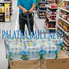 Richard Walker brings out the remaining pallet of water at the Interlachen Hitchcocks Thursday morning, but another truckload is expected Friday morning. Fran Ruchalski/Palatka Daily News