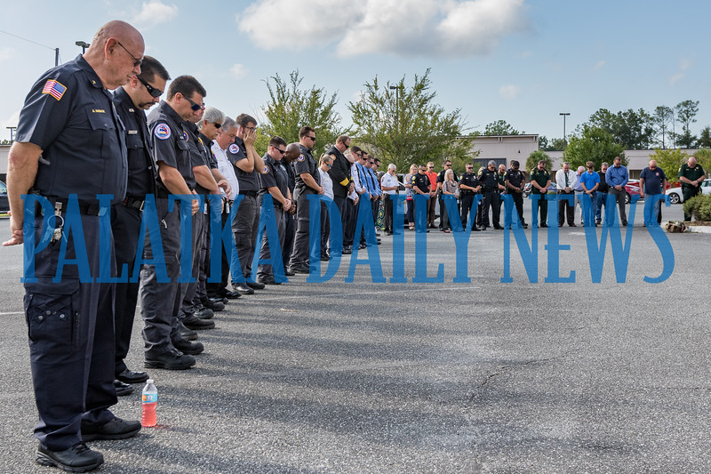 Uniformed personnel bow their heads in prayer during Pastor Terry Wright's invocation to begin the 9/11 remembrance ceremony. Fran Ruchalski/Palatka Daily News