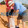 Gary Munson holds a sandbag while Leah Ramsey adds dirt at the Putnam County Public Works complex in East Palatka Friday morning to protect against rising water due to Hurricane Dorian. Fran Ruchalski/Palatka Daily News