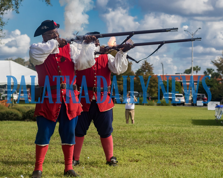 A pair of Spanish militia men from Fort Mose in St. Augustine fire off a couple of rounds at the Bartram Frolic on Saturday morning. Fran Ruchalski/Palatka Daily News