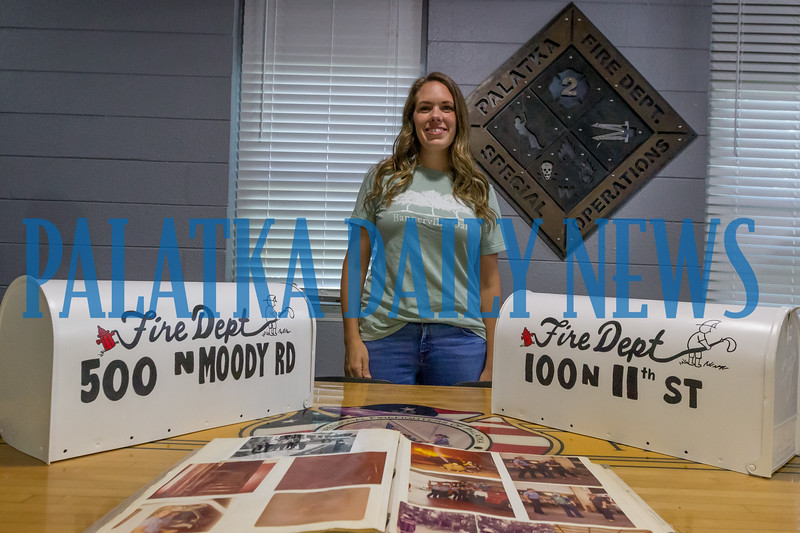 Jillian Spencer of Bannerville Oaks stands by the two mailboxes she painted for the two Palatka Fire Department stations before they get installed. Fran Ruchalski/Palatka Daily News