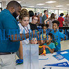 Donte Sheppard of the University of West Florida shows Destiny Solano and the Cole Family a school video on his phone at the career fair at Palatka High School Thursday night. Fran Ruchalski/Palatka Daily News