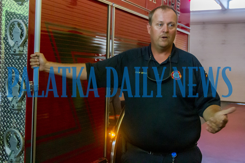Palatka Fire Chief Grimes talks about the features of the new engine and their importance to the city's firefighters. Fran Ruchalski/Palatka Daily News
