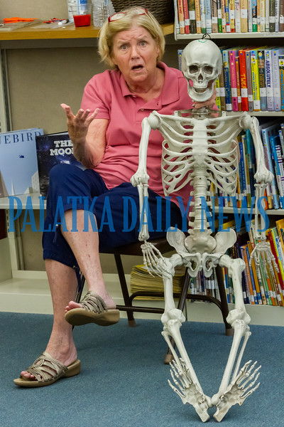 Dr. Holly Thomas uses her buddy Leonard to teach the children at the Full S.T.E.A.M. Ahead Super Science Summer program at the Melrose Library  about the joints in the body. Fran Ruchalski/Palatka Daily News