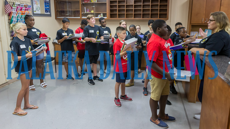 Some of the incoming sixth-graders get a tour of the student office at C. L. Overturf as part of Camp Rise which familiarized the students with the facility and each other on Thursday morning. Fran Ruchalski/Palatka Daily News