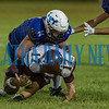 Peniel junior Aiden Sullivan (14) wraps up Old Plank receiver XXX (17) and forces an incompletion in the first half in their game. Fran Ruchalski/Palatka Daily News