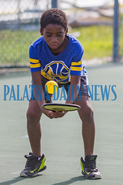 "Ten-year-old Bertram Harrison practices doing ""selfies"" during the Youth Pickleball Introductory Clinic at the John Theobold Sports Complex on Thursday morning. The clinic was one of several events Putnam County Parks & Recreation organized to celebrate Park and Recreation Month. Fran Ruchalski/Palatka Daily News"
