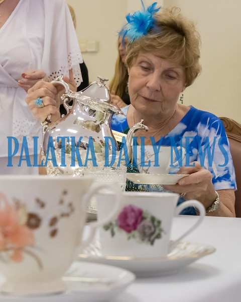 Kay Register pours tea at the Annual Membership Tea for the GFWC Woman's Club of Palatka on Thursday afternoon. The tea acquaints new and potential members with all of the things that the ladies club does and it's mission to be of service to the community. Fran Ruchalski/Palatka Daily News
