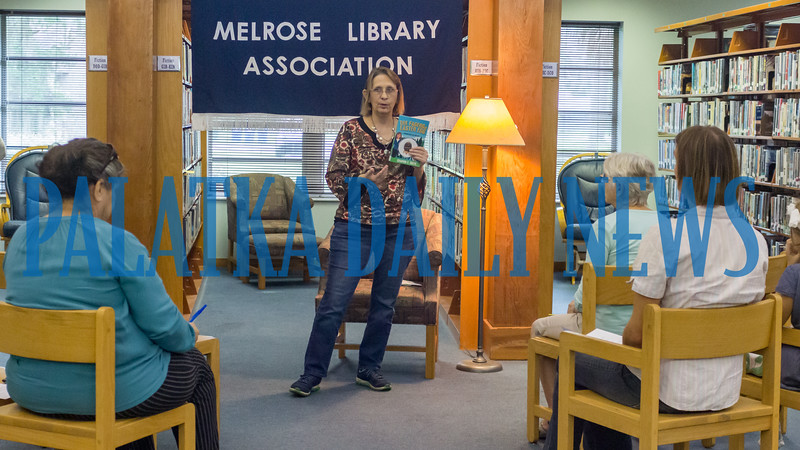 Author Sharon Buck tells folks about how she developed the characters in her book series during a mystery-writing talk at the Melrose Library on Thursday afternoon. Fran Ruchalski/Palatka Daily News