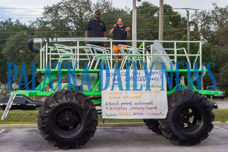 """Principal Sarajean McDaniel and assistant principal Brandon """"Tony"""" Benford hopped aboard this rolling stage to welcome everyone to the Moseley Elementary celebration of their progress. Fran Ruchalski/Palatka Daily News"""