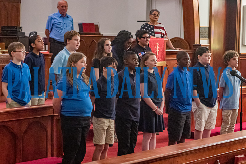 Students from the School of The Heights recited the Pledge of Allegiance and sang the National Anthem for the Cry Out America 9/11 Prayer Gathering at St. James Methodist Church at noon Wednesday. Fran Ruchalski/Palatka Daily News