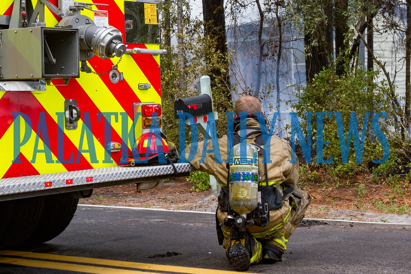 A firefighter takes a break from fighting the structure fire due to the temperatures and the intense hear of the fire. Fran Ruchalski/Palatka Daily News