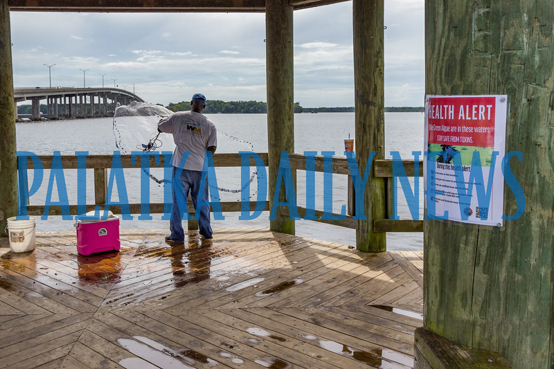 When asked about his concerns about the health risks of eating shrimp from the river, this shrimper just smiled and threw his net in again. Fran Ruchalski/Palatka Daily News