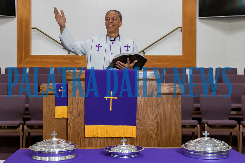 Pastor Karl Flagg stands at the pulpit in the sanctuary of Mount Tabor First Baptist Church on Friday morning. Fran Ruchalski/Palatka Daily News